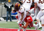 Minnesota running back Mohamed Ibrahim, left, drags Ohio State linebacker Pete Werner into the end zone for a touchdown during the first half of an NCAA college football game Saturday, Oct. 13, 2018, in Columbus, Ohio. (AP Photo/Jay LaPrete)
