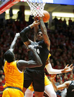 Nevada forward Jordan Caroline, center, is fouled by New Mexico's Carlton Bragg, obscured, as New Mexico's Makuach Maluach (10), of Australia, looks on during the first half of an NCAA college basketball game in Albuquerque, N.M., Saturday, Jan. 5, 2019. (AP Photo/Andres Leighton)