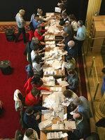 Counting in the local government elections begins at Belfast City Hall, Northern Ireland, Friday May 3, 2019. Elections were held Thursday for more than 8,000 seats on 259 local authorities across England — although not in London — and Northern Ireland. (Rebecca Black/PA via AP)