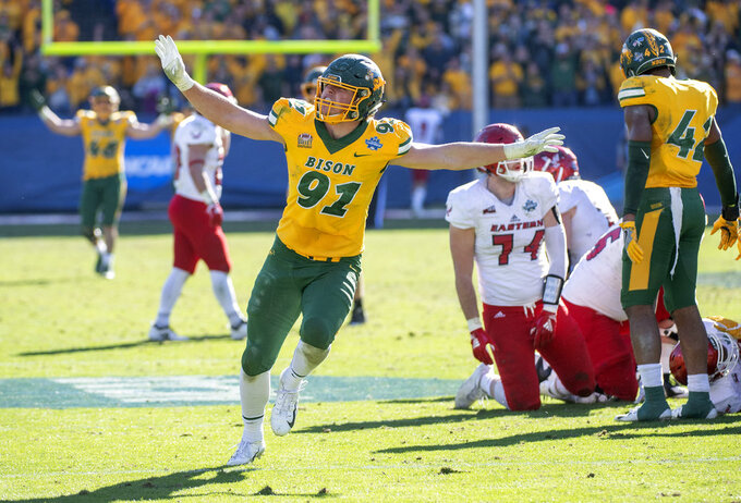 North Dakota State defensive end Derrek Tuszka (91) waves his arms like an eagle, Eastern Washington's mascot, after sacking Eastern Washington quarterback Eric Barriere in the final minutes of the FCS championship NCAA college football game, Saturday, Jan. 5, 2019, in Frisco, Texas. North Dakota State won 38-24. (AP Photo/Jeffrey McWhorter)