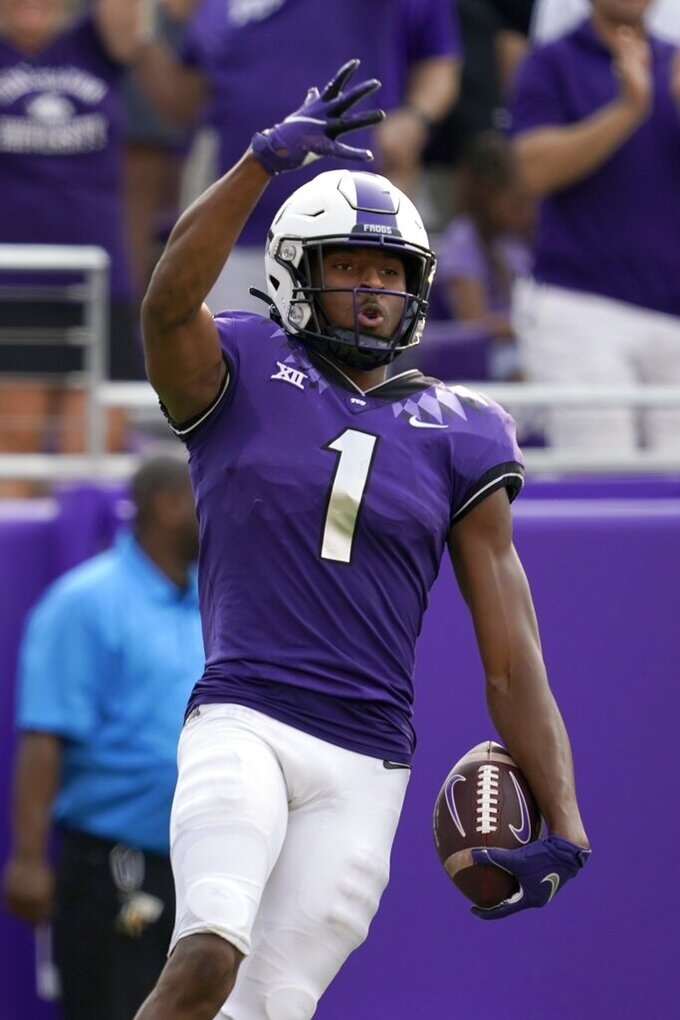 TCU wide receiver Quentin Johnston (1) celebrates catching a touchdown pass in the second half of an NCAA college football game against California in Fort Worth, Texas, Saturday, Sept. 11, 2021. (AP Photo/Tony Gutierrez)