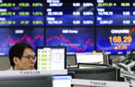 A currency trader watches monitors at the foreign exchange dealing room of the KEB Hana Bank headquarters in Seoul, South Korea, Wednesday, June 26, 2019. Asian shares were mostly lower Wednesday as investors awaited developments on the trade friction between the U.S. and China at the Group of 20 meeting of major economies in Japan later in the week. (AP Photo/Ahn Young-joon)