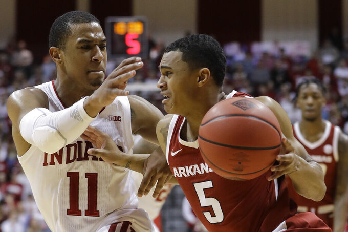Arkansas's Jalen Harris (5) goes to the basket against Indiana's Devonte Green (11) during the first half in the second round of the NIT college basketball tournament, Saturday, March 23, 2019, in Bloomington, Ind. (AP Photo/Darron Cummings)