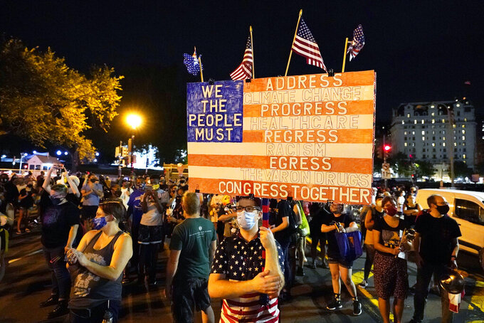 Protestors rally, Thursday night, Aug. 27, 2020, in Washington. President Donald Trump is set to deliver his acceptance speech later Thursday night from the nearby White House South Lawn.. (AP Photo/Carolyn Kaster)