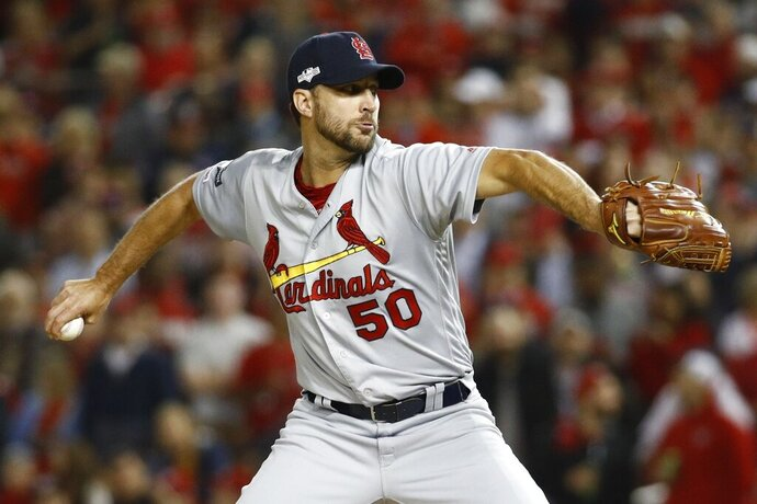 FILE - In this Oct. 15, 2019, file photo, St. Louis Cardinals relief pitcher Adam Wainwright throws during the second inning of Game 4 of the baseball National League Championship Series, in Washington. The St. Louis Cardinals and Adam Wainwright have agreed to a contract for next season, raising the likelihood that the veteran pitcher finishes his career with the only major league team he has ever played for. Terms of the deal Tuesday, Nov. 12, 2019, were not disclosed.(AP Photo/Patrick Semansky, File)