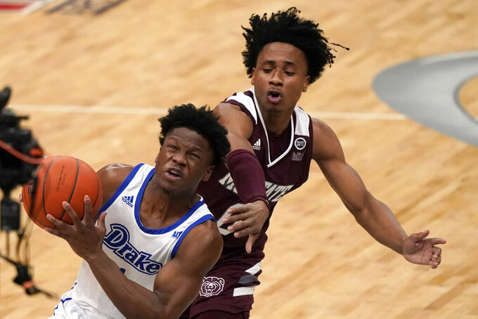 Drake's Joseph Yesufu, left, heads to the basket as Missouri State's Demarcus Sharp defends during the first half of an NCAA college basketball game in the semifinal round of the Missouri Valley Conference men's tournament Saturday, March 6, 2021, in St. Louis. (AP Photo/Jeff Roberson)