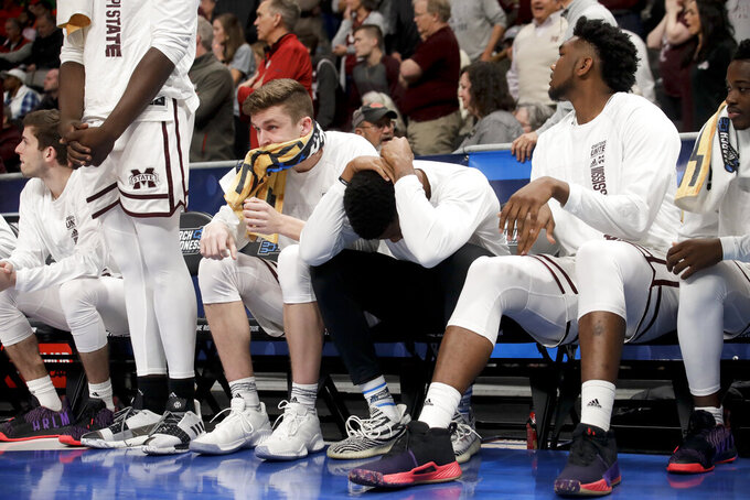 Mississippi State reacts to a loss to Liberty during a first-round game in the NCAA men's college basketball tournament Friday, March 22, 2019, in San Jose, Calif. (AP Photo/Jeff Chiu)