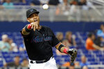 Miami Marlins third baseman Starlin Castro throws to first to put out Kansas City Royals' Jorge Lopez at first during the third inning of a baseball game Friday, Sept. 6, 2019, in Miami. (AP Photo/Wilfredo Lee)