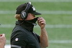 Las Vegas Raiders head coach Jon Gruden adjusts his protective mask along the sideline in the second half of an NFL football game against the New England Patriots, Sunday, Sept. 27, 2020, in Foxborough, Mass. (AP Photo/Steven Senne)