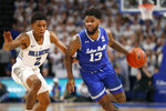 Seton Hall's Myles Powell (13) drives around Saint Louis' Tay Weaver (2) during the first half of an NCAA college basketball game Sunday, Nov. 17, 2019, in St. Louis. (AP Photo/Jeff Roberson)