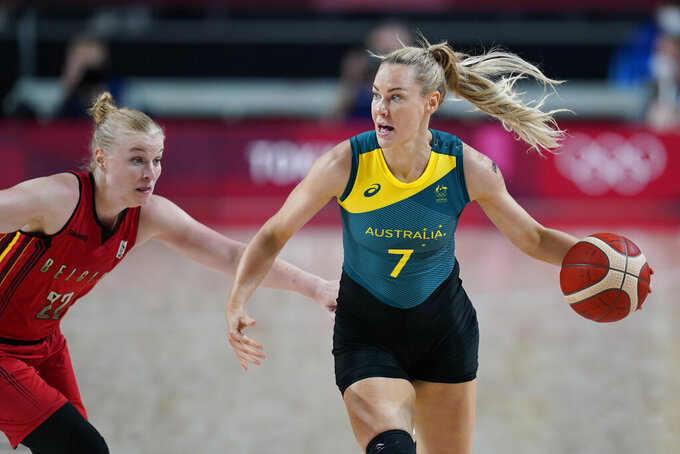 Australia's Tess Madgen (7) drives up court past Belgium's Hanne Mestdagh (22) during a women's basketball preliminary round game at the 2020 Summer Olympics, Tuesday, July 27, 2021, in Saitama, Japan. (AP Photo/Charlie Neibergall)