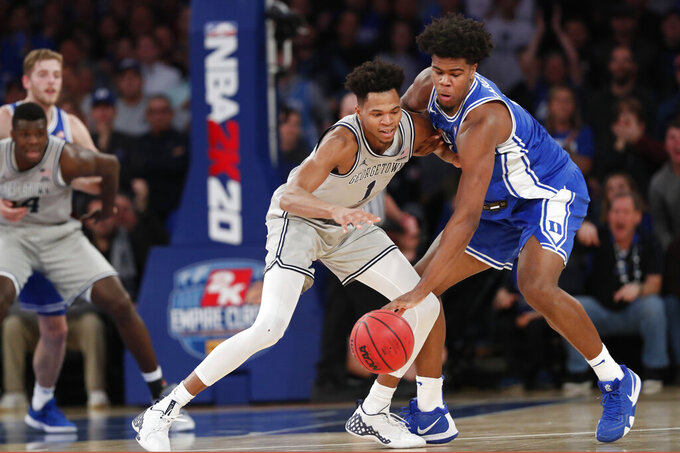 Duke center Vernon Carey Jr., right, steals the ball from Georgetown forward Jamorko Pickett during the first half of an NCAA college basketball game in the 2K Empire Classic, Friday, Nov. 22, 2019 in New York. (AP Photo/Kathy Willens)