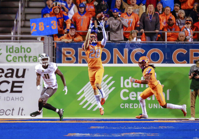 Boise State safety Kekaula Kaniho (28) intercepts ball in front of Colorado State wide receiver Preston Williams (11) in the first half of an NCAA college football game, Friday, Oct. 19, 2018, in Boise, Idaho. (AP Photo/Steve Conner)