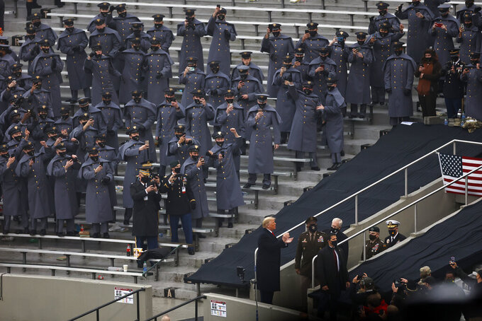 Army cadets cheer as President Donald Trump is introduced before an NCAA college football game between Navy and Army on Saturday, Dec. 12, 2020, in West Point, N.Y. (AP Photo/Adam Hunger)