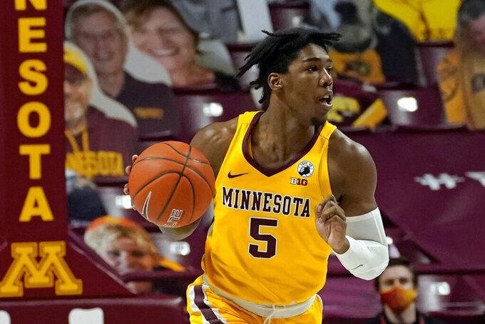 FILE - Minnesota's Marcus Carr (5) plays in an NCAA college basketball game against Nebraska in Minneapolis, in this Monday, Feb. 8, 2021, file photo. Carr is a member of The AP All-Big Ten first team, announced Tuesday, March 9, 2021. (AP Photo/Jim Mone, File)