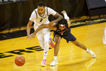Missouri's Xavier Pinson, left, battles Liberty's Chris Parker, right, for a loose ball during the second half of an NCAA college basketball game Wednesday, Dec. 9, 2020, in Columbia, Mo. Missouri won 69-60. (AP Photo/L.G. Patterson)