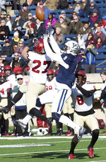 Harvard's Cody Thompson, left, breaks up a pass play to Yale's Patrick Conte during the first half during an NCAA college football game, Saturday, Nov. 23, 2019, in New Haven, Conn. (Arnold Gold/New Haven Register via AP)