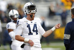 Penn State quarterback Sean Clifford plays the air guitar during warmups for the team's NCAA college football game against Iowa, Saturday, Oct. 12, 2019, in Iowa City, Iowa. (AP Photo/Matthew Putney)
