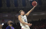 Liberty guard Elijah Coffee (120) drives to basket against Lipscomb during the first half of the Atlantic Sun conference NCAA basketball championship game in Lynchburg, Va., Sunday, March 8, 2020. (AP Photo/Lee Luther Jr.)