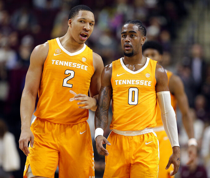 Tennessee forward Grant Williams (2) and guard Jordan Bone (0) talk as they head to the free throw line after a foul during the first half of an NCAA college basketball game against Texas A&M, Saturday, Feb. 2, 2019, in College Station, Texas. (AP Photo/Michael Wyke)