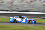 Kyle Larson (5) drives through a turn during practice for the NASCAR Cup Series auto race at Indianapolis Motor Speedway in Indianapolis, Saturday, Aug. 14, 2021. (AP Photo/Michael Conroy)