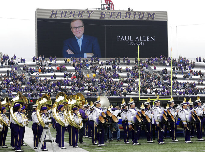 Members Washington Huskies band stand on the field during a moment of silence in tribute to Microsoft founder and philanthropist Paul Allen, who died Monday, Oct. 15, 2018, before an NCAA college football game between Washington and Colorado, Saturday, Oct. 20, 2018, in Seattle. (AP Photo/Ted S. Warren)