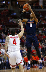 Illinois guard Alan Griffin, right, goes up for a shot against Ohio State guard Duane Washington during the first half of an NCAA college basketball game in Columbus, Ohio, Thursday, Feb. 14, 2019. (AP Photo/Paul Vernon)
