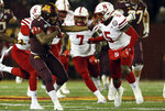 Minnesota running back Rodney Smith (1) holds off Nebraska cornerback Cam Taylor-Britt during an NCAA college football game Saturday, Oct. 12, 2019, in Minneapolis. (AP Photo/Stacy Bengs)