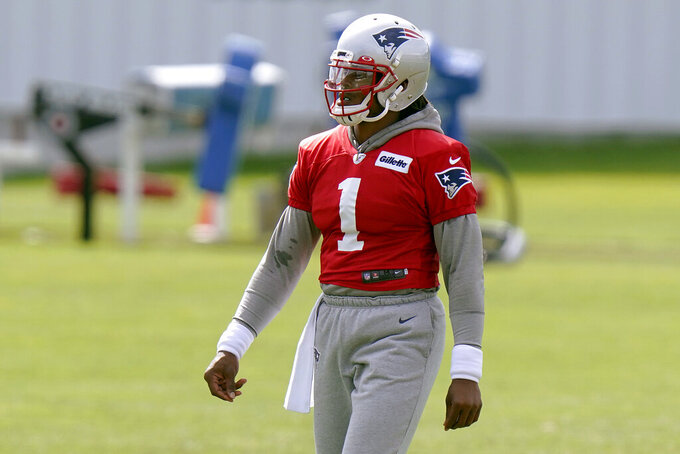 New England Patriots quarterback Cam Newton walks on the field during an NFL football training camp practice, Wednesday, Aug. 26, 2020, in Foxborough, Mass. (AP Photo/Steven Senne, Pool)