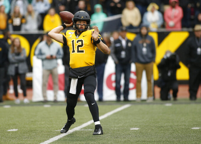 Appalachian State quarterback Zac Thomas (12) throws to an open receiver during the first half of an NCAA college football game Saturday, Oct. 19, 2019, in Boone, NC. (AP Photo/Brian Blanco)
