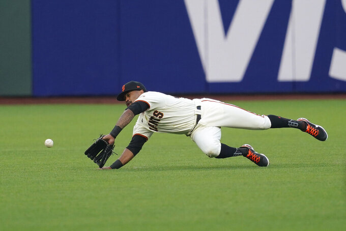 San Francisco Giants right fielder Jaylin Davis cannot catch a base hit by San Diego Padres' Wil Myers during the third inning of a baseball game in San Francisco, Tuesday, July 28, 2020. (AP Photo/Jeff Chiu)