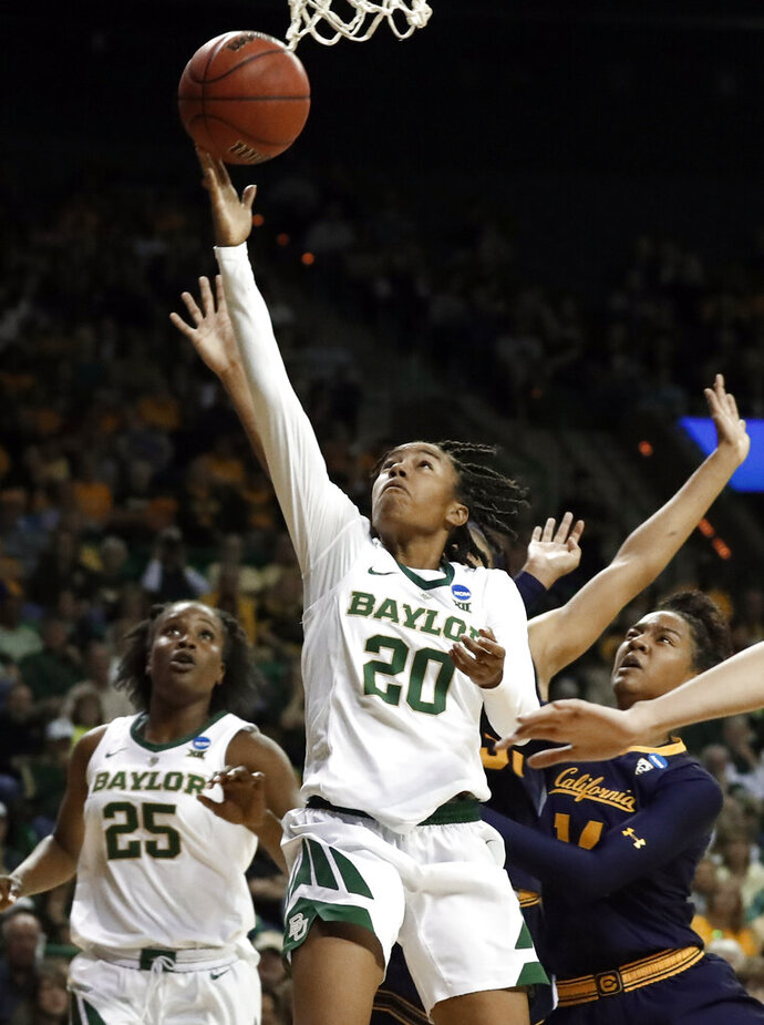 Baylor guard Juicy Landrum (20) goes up to shoot after getting past California guard Kianna Smith, right, in the second half of a second-round game in the NCAA women's college basketball tournament in Waco, Texas, Monday, March 25, 2019. (AP Photo/Tony Gutierrez)