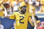 West Virginia quarterback Jarret Doege (2) makes a pass against Virginia Tech during the first half of an NCAA college football game in Morgantown, W.Va., Saturday, Sep. 18, 2021. (AP Photo/William Wotring)