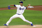 Texas Rangers starting pitcher Mike Minor delivers in the first inning against the Colorado Rockies in a baseball game Saturday, July 25, 2020, in Arlington, Texas. (AP Photo/Richard W. Rodriguez)