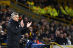 Manchester United's manager Ole Gunnar Solskjaer applauds during the English FA Cup third round soccer match between Wolverhampton Wanderers and Manchester United at the Molineux Stadium in Wolverhampton, England, Saturday, Jan. 4, 2020. (AP Photo/Rui Vieira)
