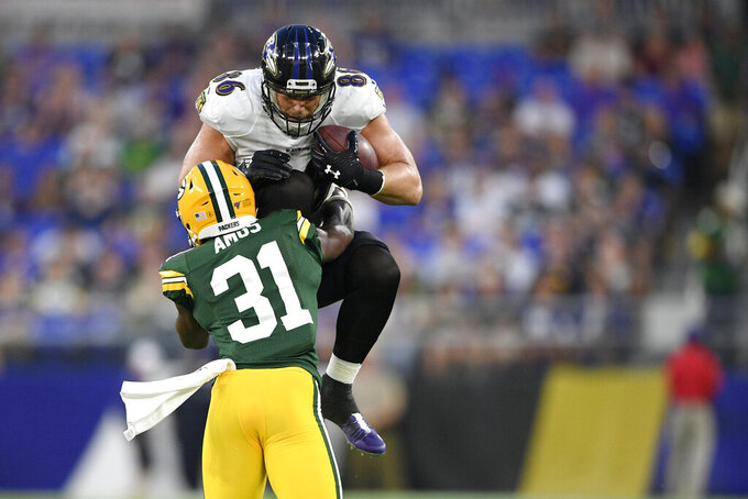 Baltimore Ravens tight end Nick Boyle, top, is stopped while trying to leap over Green Bay Packers strong safety Adrian Amos during the first half of a NFL football preseason game, Thursday, Aug. 15, 2019, in Baltimore. (AP Photo/Nick Wass)