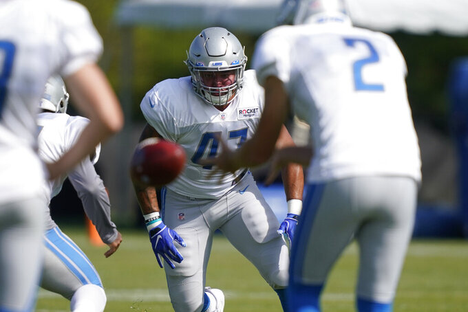 Detroit Lions fullback Luke Sellers (47) rushes punter Arryn Siposs (2) during drills at the Lions NFL football camp practice, Monday, Aug. 17, 2020, in Allen Park, Mich. (AP Photo/Carlos Osorio)