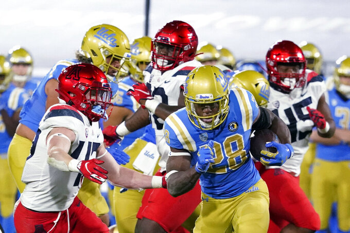 UCLA running back Brittain Brown (28) carries against the Arizona during the first half of an NCAA college football game Saturday, Nov. 28, 2020, in Pasadena, Calif. (AP Photo/Marcio Jose Sanchez)