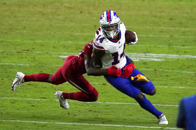 FILE- In this Sunday, Nov. 15, 2020, file photo, Buffalo Bills wide receiver Stefon Diggs (14) tries to turn upfield after a reception during an NFL football game against the Arizona Cardinals, in Glendale, Ariz. Painted rightly or wrongly as yet another one of the NFL's many diva receivers for his various sideline outbursts during his first five seasons in Minnesota, Diggs has put behind his mercurial past by quickly warming up to his new surroundings. (AP Photo/Rick Scuteri, File)