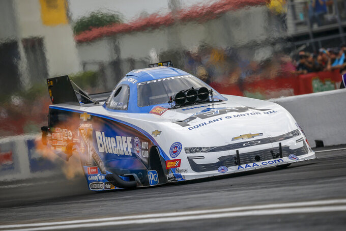 In this photo provided by the NHRA, John Force drives in Funny Car qualifying at the Mopar Express Lane NHRA SpringNationals drag races at Houston Raceway Park on Friday, April 12, 2019, in Baytown, Texas. (Randy Anderson/NHRA via AP)