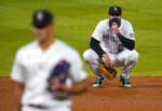 Colorado Rockies third baseman Nolan Arenado, back, waits for relief pitcher Jesus Tinoco to throw to Los Angeles Dodgers' Cody Bellinger during the ninth inning of a baseball game Thursday, Sept. 17, 2020, in Denver. The Dodgers won 9-3. (AP Photo/David Zalubowski)
