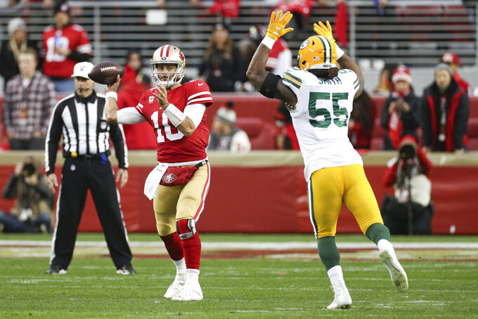 San Francisco 49ers quarterback Jimmy Garoppolo (10) looks downfield for a receiver in the NFL NFC Championship football game against the Green Bay Packers, Sunday, Jan. 19, 2020 in Santa Clara, Calif. The 49ers defeated the Packers 37-20. (Margaret Bowles via AP)