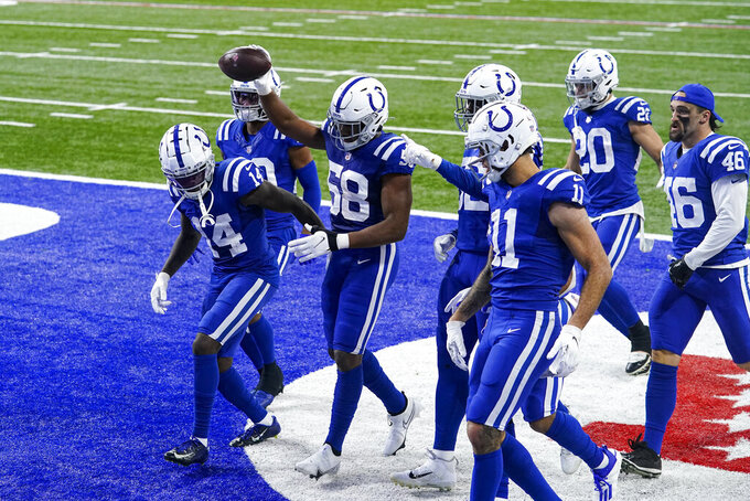 Indianapolis Colts outside linebacker Bobby Okereke (58) celebrates with teammates after recovering a fumble by the Houston Texans in the final minute of the second half of an NFL football game in Indianapolis, Sunday, Dec. 20, 2020. (AP Photo/Darron Cummings)