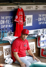 Los Angeles Angels manager Brad Ausmus sits on the bench in front of the jersey of Tyler Skaggs during a baseball game against the Texas Rangers in Arlington, Texas, Tuesday, July 2, 2019. (AP Photo/Tony Gutierrez)