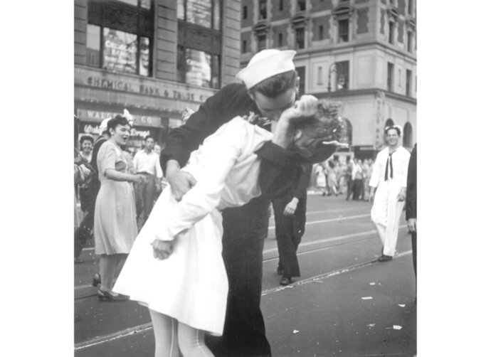 FILE - In this Aug. 14, 1945 file photo provided by the U.S. Navy, a sailor and a woman kiss in New York's Times Square, as people celebrate the end of World War II. The ecstatic sailor shown kissing a woman in Times Square celebrating the end of World War II has died. George Mendonsa was 95. This image was taken by U.S. Navy photographer Victor Jorgensen. The photo is of the same moment that photographer Alfred Eisenstaedt captured and first published in Life magazine. (Victor Jorgensen/U.S. Navy, File)