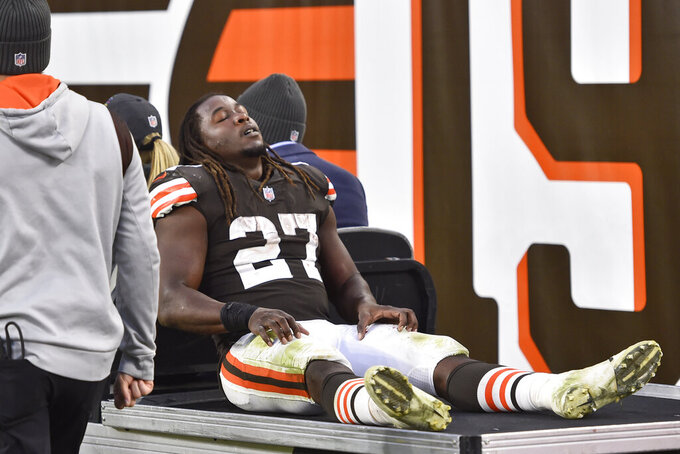 Cleveland Browns running back Kareem Hunt (27) is carted off the field after an injury during the second half of an NFL football game against the Arizona Cardinals, Sunday, Oct. 17, 2021, in Cleveland. (AP Photo/David Richard)