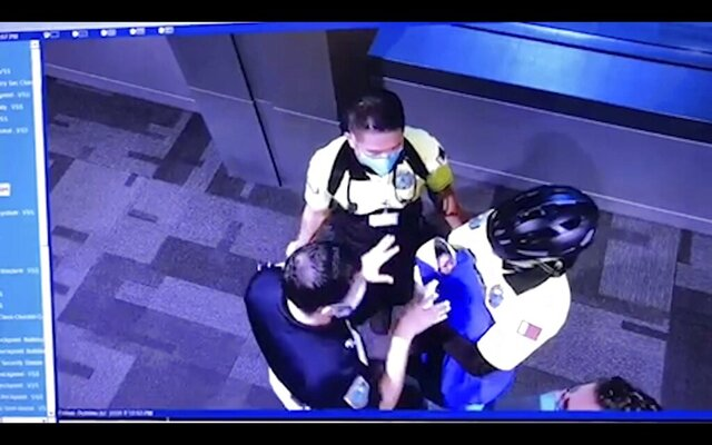 This image made from the Oct. 2, 2020, surveillance camera footage obtained by the website Doha News shows officials care for an abandoned baby at Hamad International Airport in Doha, Qatar. Qatar apologized Wednesday, Oct. 28, 2020, after authorities forcibly examined female passengers from a Qatar Airways flight to Sydney to try to identify who might have given birth to the abandoned newborn baby, even as Australia said it was only one of 10 flights subjected to the searches. (Courtesy of Doha News via AP)