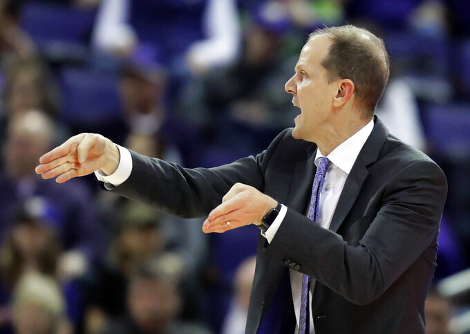 Washington head coach Mike Hopkins calls to his team during the first half of an NCAA college basketball game against Washington State, Saturday, Jan. 5, 2019, in Seattle. (AP Photo/Ted S. Warren)