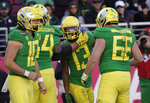 Oregon wide receiver Dillon Mitchell (13) celebrates with Brady Aiello (66) and Calvin Throckmorton (54) after scoring a touchdown against Michigan State during the second half of the Redbox Bowl NCAA college football game Monday, Dec. 31, 2018, in Santa Clara, Calif. Oregon won 7-6. (AP Photo/Tony Avelar)
