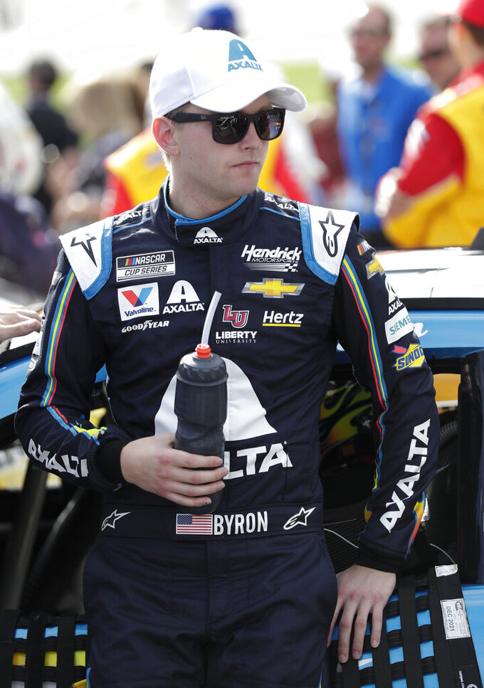 William Byron leans against his car during activities before the NASCAR Daytona 500 auto race at Daytona International Speedway, Sunday, Feb. 16, 2020, in Daytona Beach, Fla. (AP Photo/John Raoux)